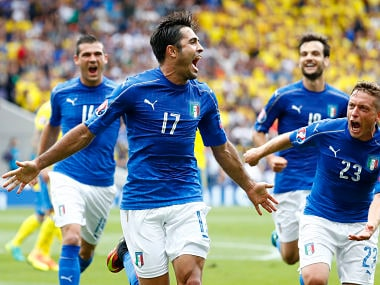 Italy's Eder (2nd L) celebrates with teammates after scoring their first goal. Reuters