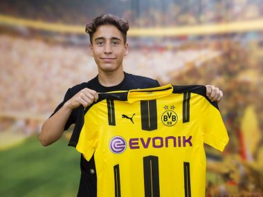 Borussia Dortmund's new signing Emre Mor poses with the club jersey. Image Courtesy: Borussia Dortmund Twitter