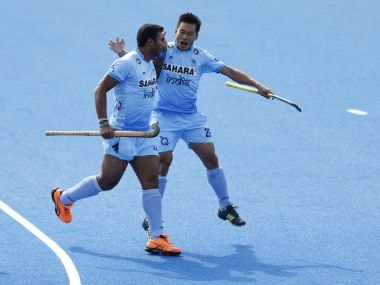 India's Raghunath Vokkaliga celebrates scoring the first goal during the Pool game between Germany and India. AP