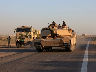 Iraqi military forces on the outskirts of Fallujah. AP