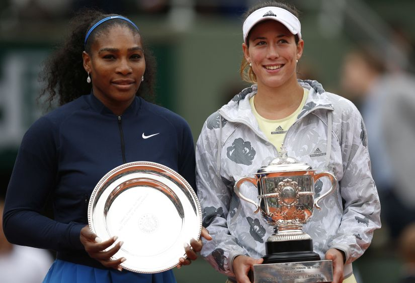 Garbine Muguruza, right, and Serena Williams hold their trophies after the French Open final. AP