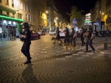 Police patrol a street  in Marseille, France. AP