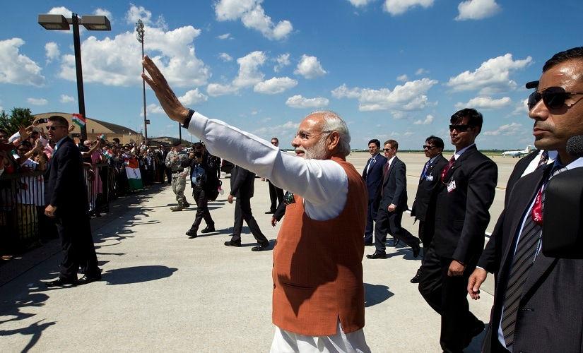 Prime Minister Narendra Modi waves to members of the indian community in Washington upon his arrival at Andrews Air Force Base. AP