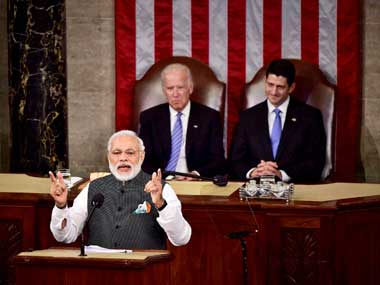 Prime Minister Narendra Modi gestures while addressing a joint meeting of Congress on Capitol Hill in Washington on Wednesday. Vice President Joe Biden and House Speaker Paul D. Ryan are seen at the behind. PTI