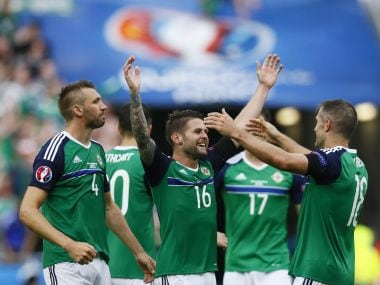 Northern Ireland's Gareth McAuley, Oliver Norwood and Aaron Hughes celebrate win over Ukraine. Reuters