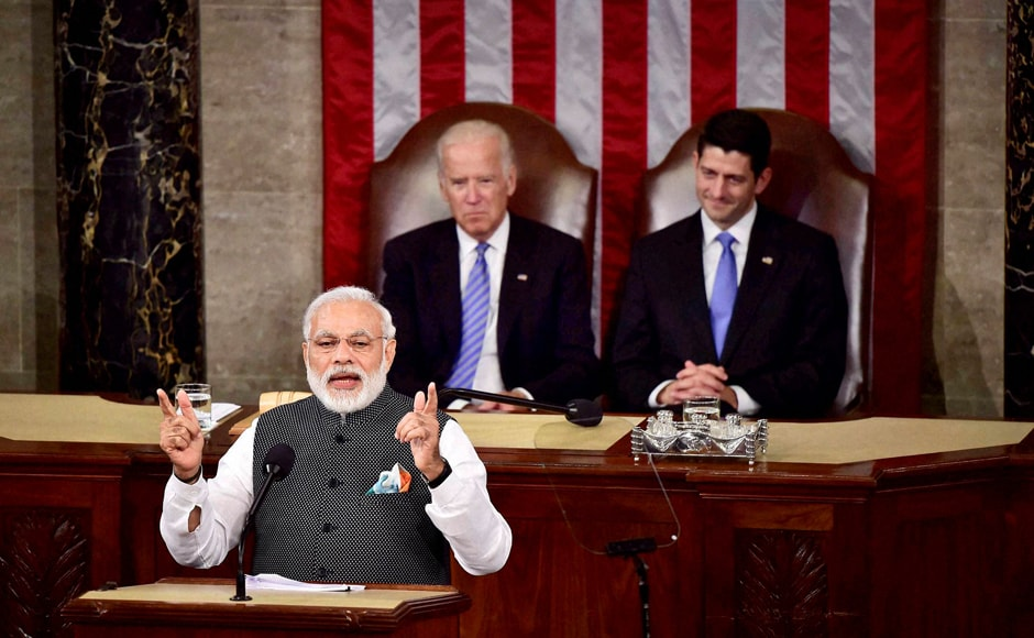 PM Narendra Modi gestures while addressing a joint meeting of Congress on Capitol Hill in Washington. Vice President Joe Biden and House Speaker Paul Ryan are seen in the background. PTI