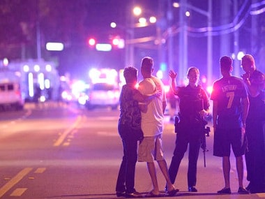 Orlando Police officers direct family members away from the multiple shooting at a nightclub in Orlando. AP.