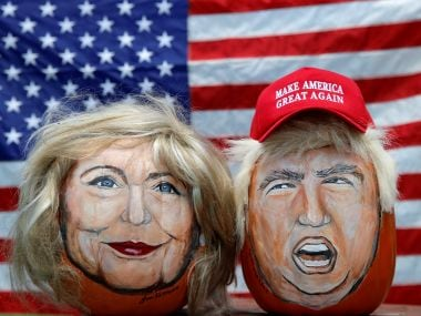The images of Hillary Clinton and Donald Trump painted on decorative pumpkins created by artist John Kettman. Reuters