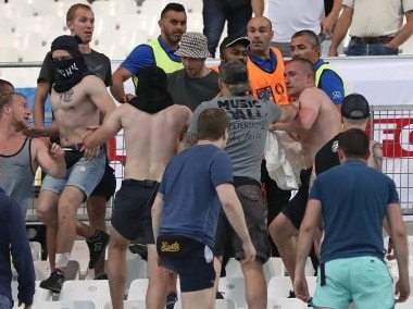 Stewards calm Russian supporters after clashes broke out in the stands during Euro 2016. AP
