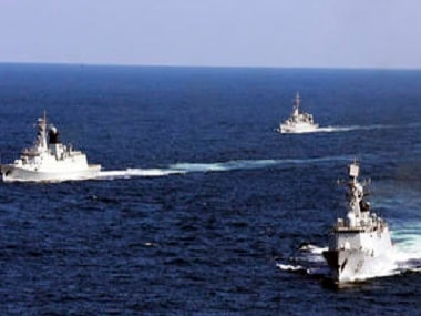 A file photo of Chinese navy vessels taking part in a drill in the waters off Zhoushan in east China's Zhejiang province. Despite pressure from Washington and elsewhere, China appears determined to avoid granting any hint of legitimacy to the U.N. abitration tribunal that might challenge its claim to ownership of virtually the entire South China Sea, including its islands, reefs, fish stocks and potentially rich reserves of oil and gas. (AP Photo/File) CHINA OUT