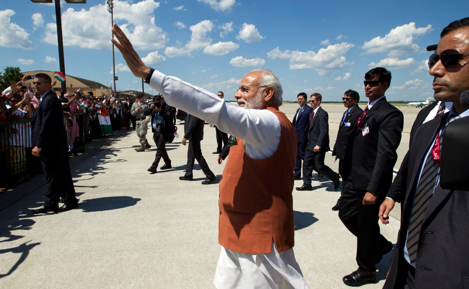 PM Narendra Modi waves to member of the indian community in Washington. AP