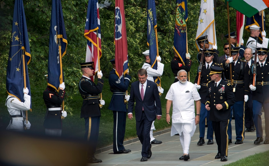 PM Narendra Modi with Secretary of Defense Ash Carter and Maj Gen Bradley Becker arrive to lay a wreath at the Tomb of the Unknowns at Arlington National Cemetery, in Arlington, Va. AP