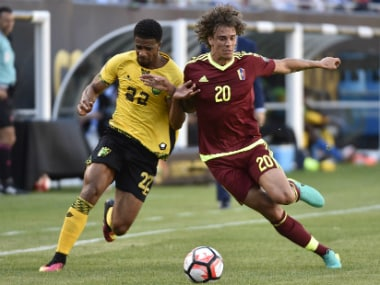Jamaica's Garath McCleary fights for the ball with Venezuela's Rolf Feltscher during the Copa America clash. AFP