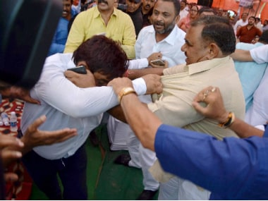 A BJP councillor beating up an AAP councillor Rakesh at MCD joint Session at Ramlila Maidan in New Delhi on Thursday. PTI