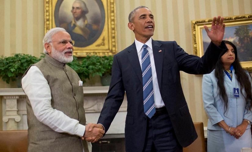 Barack Obama and Prime Minister India Narendra Modi shake hands in the Oval Office of the White House on Tuesday. PTI