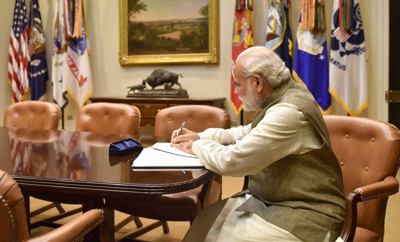 Narendra Modi signing the visitors' book, at White House on Tuesday. PTI