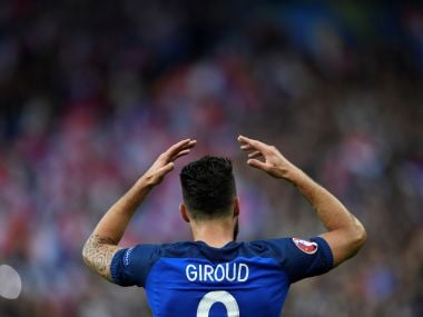 France's forward Olivier Giroud celebrates scoring the opening goal during the Euro 2016 quarter-final. AFP