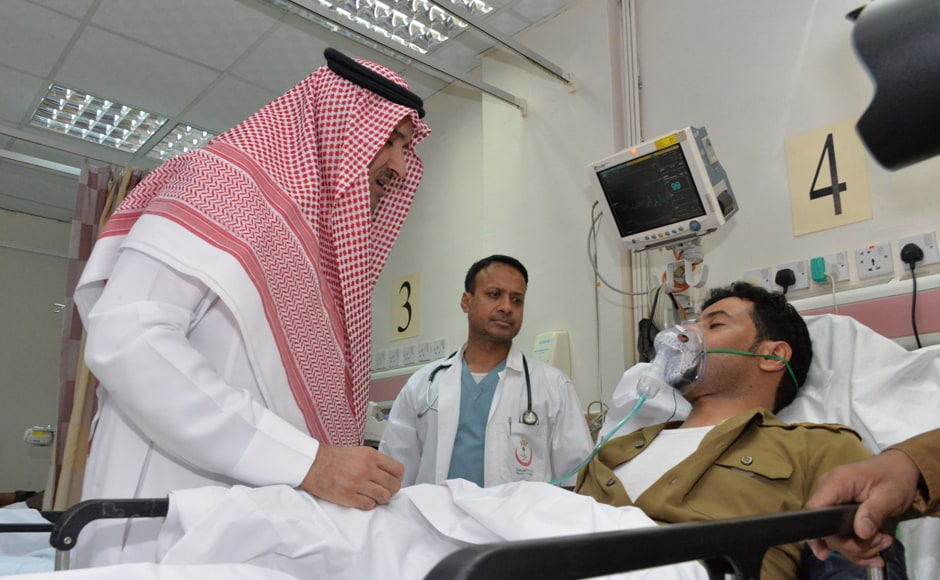 Saudi Emir of Medina Prince Faisal bin Salman bin Abdulaziz (L) visits an injured policeman at a local hospital after the suicide attack. Four Saudi security personnel were killed and five others were wounded in a suicide bombing on Mosque in Medina, the interior ministry said. Photo Courtesy: AFP