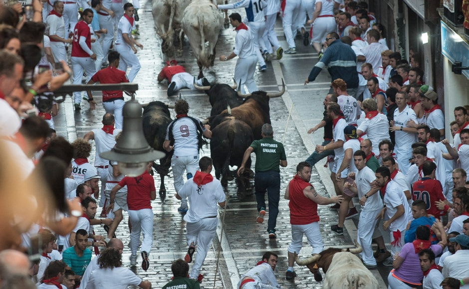 "The festival in honour of the patron saint of Spain's northern Navarra region - <span class=""highlight"">San</span> <span class=""highlight"">Fermin</span>- dates back to medieval times and combines religious processions, all-night partying and hair-raising daily <span class=""highlight"">bull</span> runs. AFP."