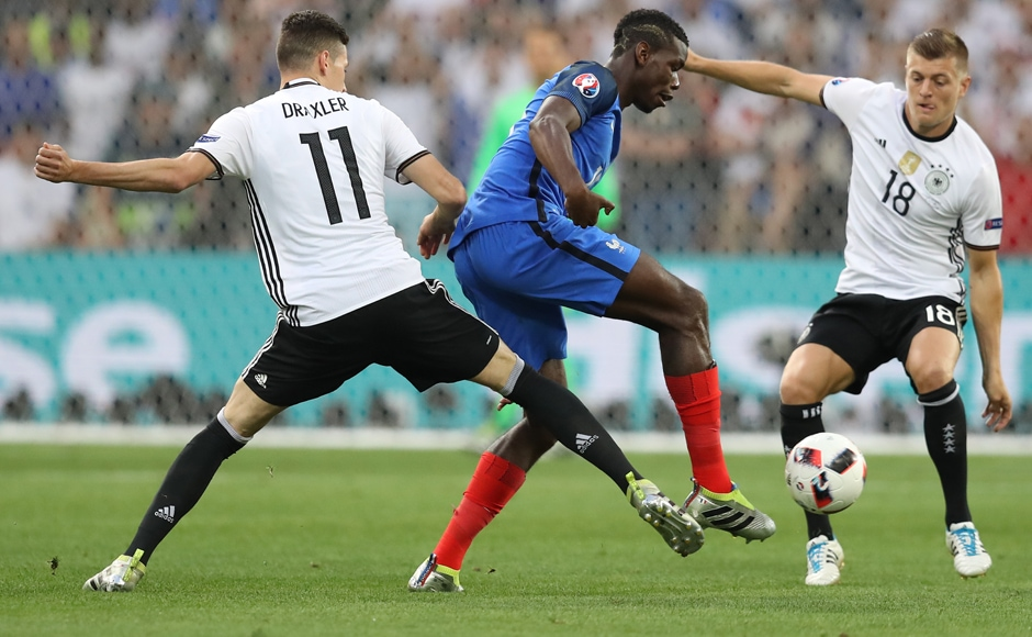 Paul Pogba vies for the ball with Julian Draxler and Toni Kroos. It was Pogba's cross that was cleared by Neuer into the Antoine Griezmann 's path to fire home. AFP