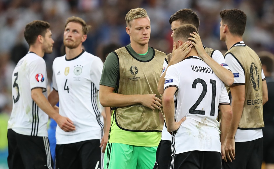 Germany's players reacts after the Euro 2016 semi-final loss to France. The World Champions lost 2-0. AFP