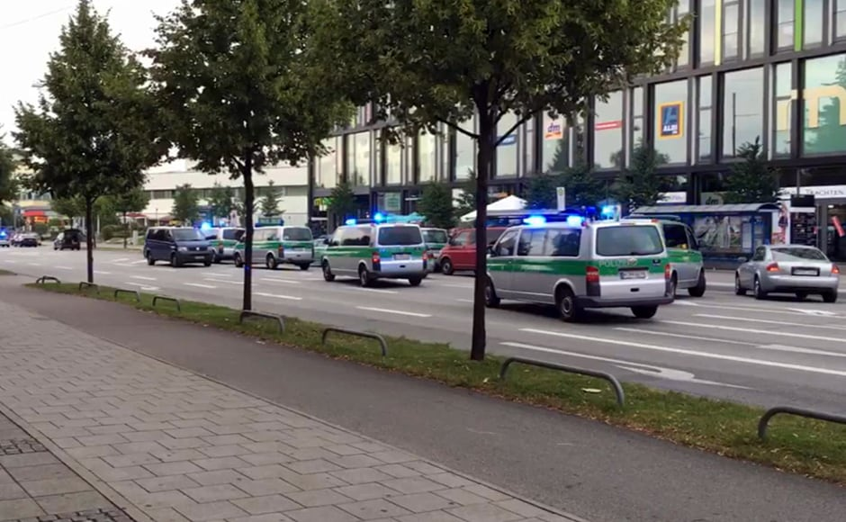 """Police warned of an """"acute terror"""" situation in the southern German city, which saw panicked shoppers fleeing the mall as armed police roamed the streets on the hunt for the attackers. Three gunmen are still at large. Associated Press Television via AP"""