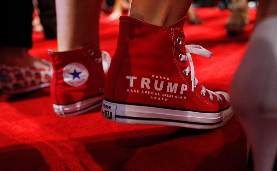"""""""Make America Great Again"""" running shoes at the RNC. Despite costs totalling more than 10 million dollars in insurance alone against the possibility of violent protest, Cleveland, which last staged the convention in 1936, is confident of making a decent profit out the event. Reuters"""