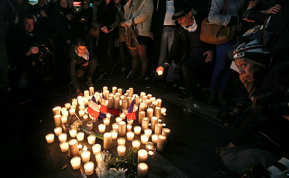 People place candles in a circle during a vigil in a tribute to the victims of the Bastille Day tragedy, in Sydney, Australia, on Friday, 15 July , 2016. World leaders are expressing dismay, sadness and solidarity with France over the attack carried out by a man who drove truck into crowds of people celebrating France's national day in Nice. AP