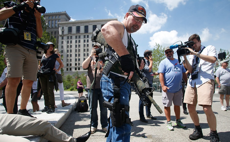Steve Thacker carrying a rifle and a handgun is surrounded by news media in a public square in Cleveland. Ohio is an open-carry state and allows anyone above the age of 21 who has a licence to carry their firearm openly. The head of Cleveland's police union wrote to Governor John Kasich asking him to suspend the open-carry law for the duration of the RNC. However, Kasich rejected the request, saying that he does not have the power to do so. Reuters
