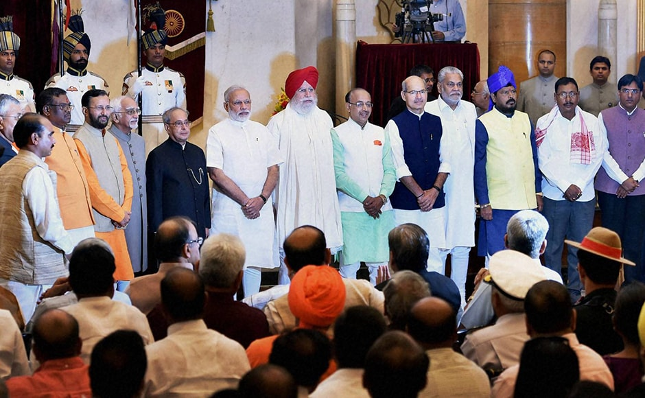 Vice President Hamdi Ansari, President Pranab Mukherjee and PM Narendra Modi with the newly sworn-in ministers. A total of 19 new MPs were sworn-in as junior ministerswhile Prakash Javadekar was promoted to the Cabinet rank at the swearing-in ceremony at Rashtrapati Bhavan in New Delhi on Tuesday. PTI