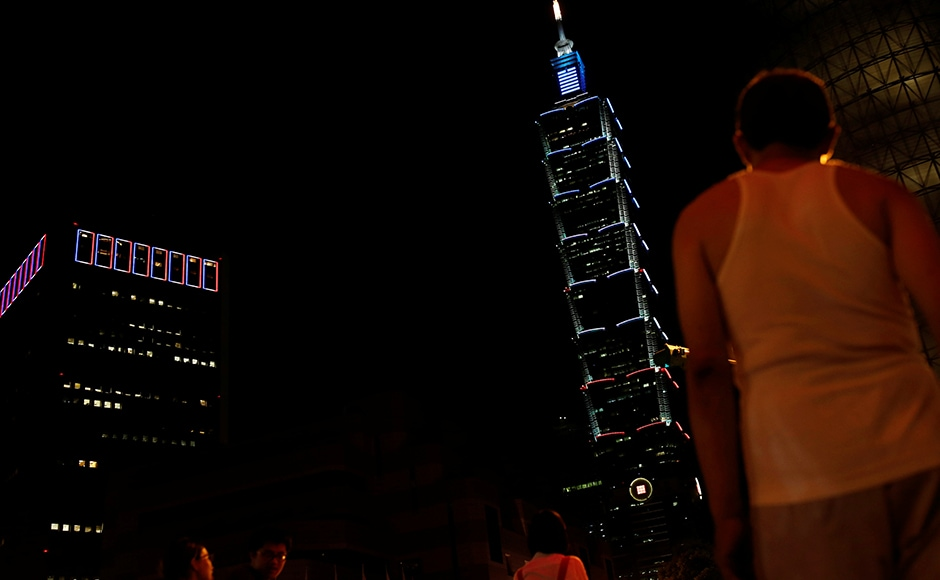 Taiwan's landmark building Taipei 101 is lit up in blue, white and red, the colours of the French flag, following the Bastille Day killings in Nice, in Taipei, Taiwan on 15 July 2016. Reuters