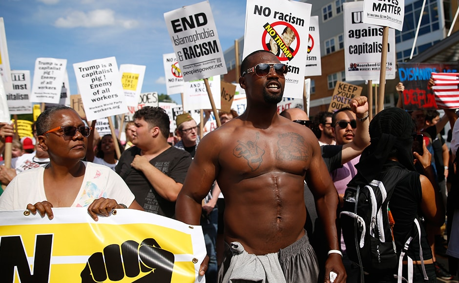 Demonstrators hold placards during a march by various groups, including 'Black Lives Matter' and 'Shut Down Trump and the RNC' ahead of the convention. Trump had earlier said that Black Lives Matter is dividing America. Reuters