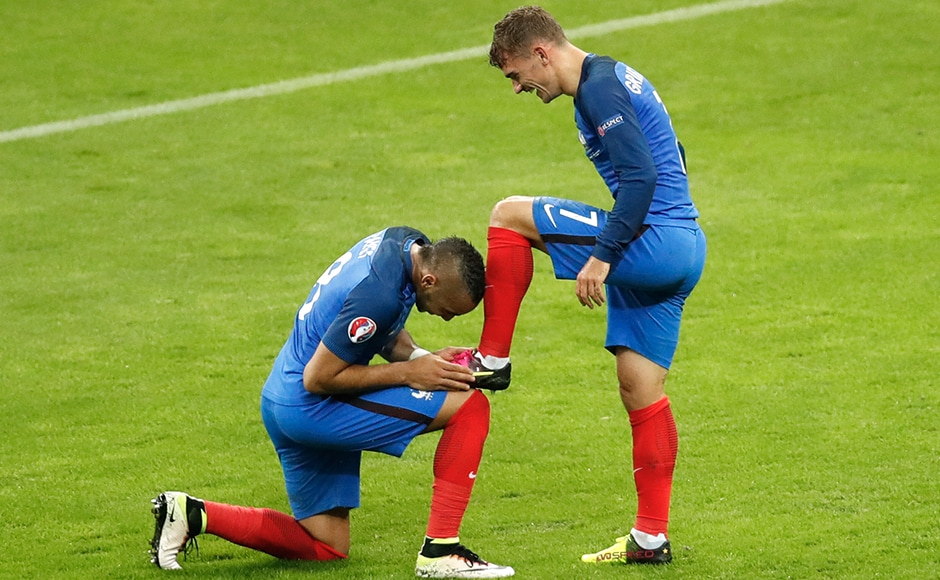 France's Dimitri Payet kisses the shoelaces of his team-mate Antoine Griezmann who scored France's fourth goal of the evening. Griezmann and Payet have been the pick of the players for the hosts so far. AP
