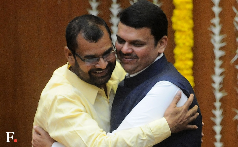 Sadabhau Khot is congratulated by CM Fadnavis after being inducted as minister of state. Khot belongs to the Shetkari Swabhiman Party. Sachin Gokhale/Firstpost