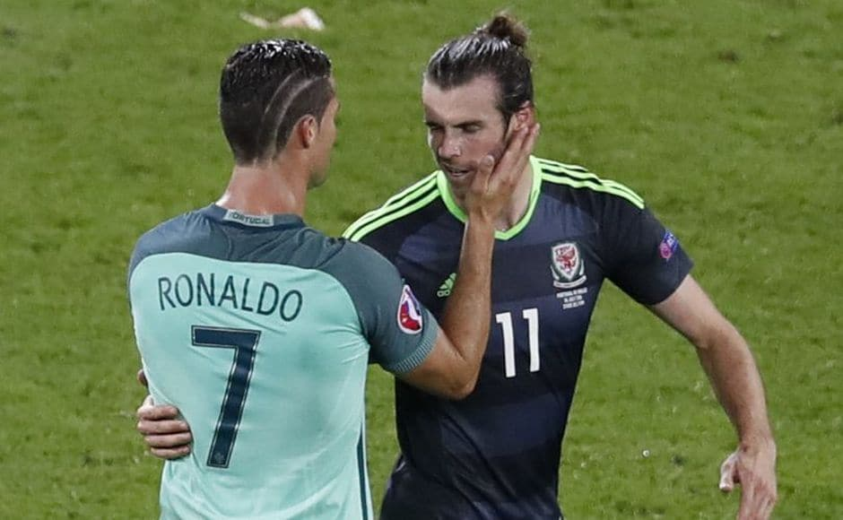 Real Madrid team-mates Cristiano Ronaldo and Gareth Bale greet each other after the game as the Portuguese consoles Welshman Bale. AP