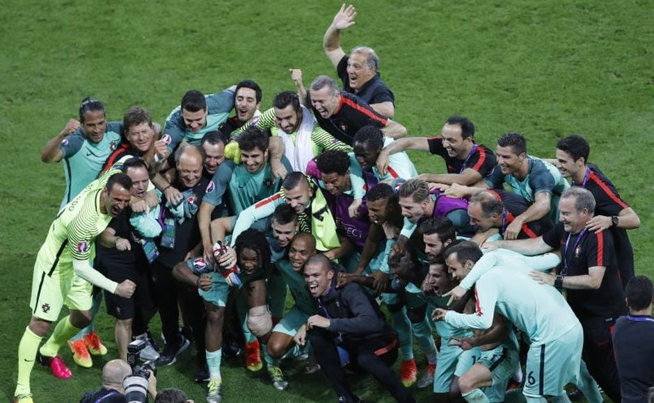 Portugal team and staff celebrate their win in the semi-final posing for a group photo after the game. AP