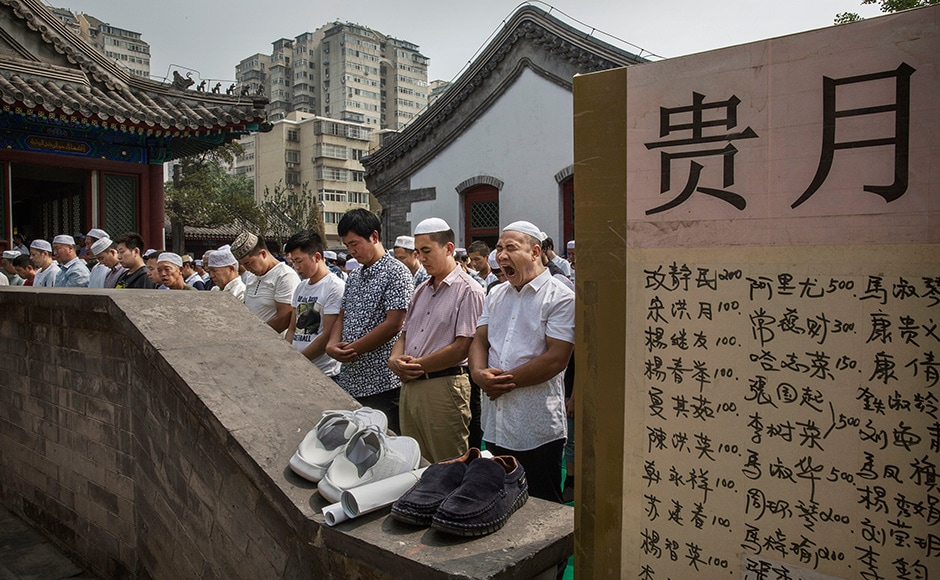 Beijing, China: Muslims for Eid prayers at the historic Niujie Mosque on 6 July. Islam in China dates back to the 10th century as the legacy of Arab traders who ventured from the Middle East along the ancient Silk Road. Getty images