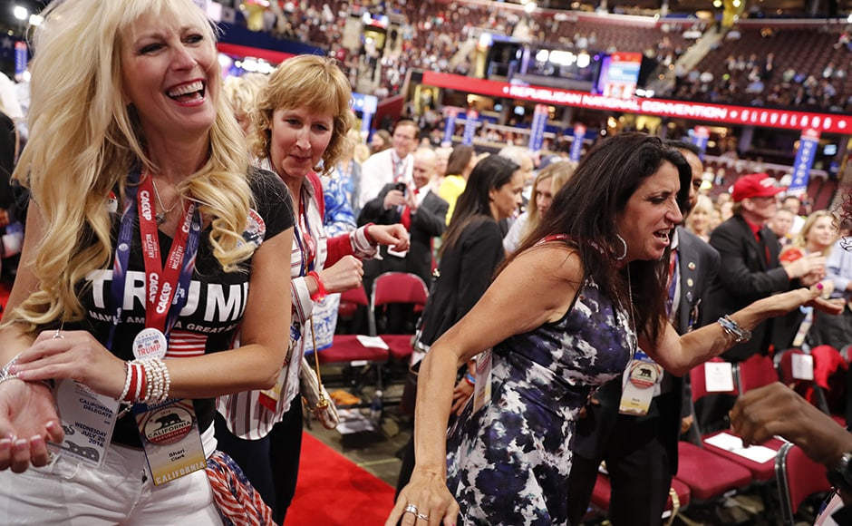 Female delegates dance during the third session of the convention. The event saw its fair share of controversies with allegations against Melania Trump for plagiarising her speech and Ted Cruz being booed for refusing to endorse Trump despite being a prime time speaker. Reuters