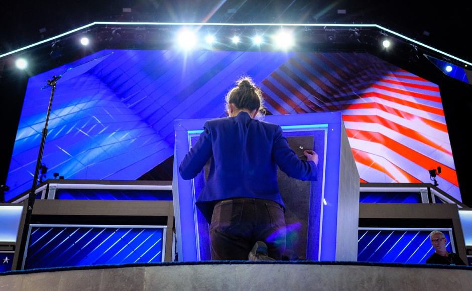 Final touches are made to the podium Sunday evening. US President Barack Obama will speak on Wednesday night. Other high-profile speakers include former President Bill Clinton and Vice President Joe Biden. AP