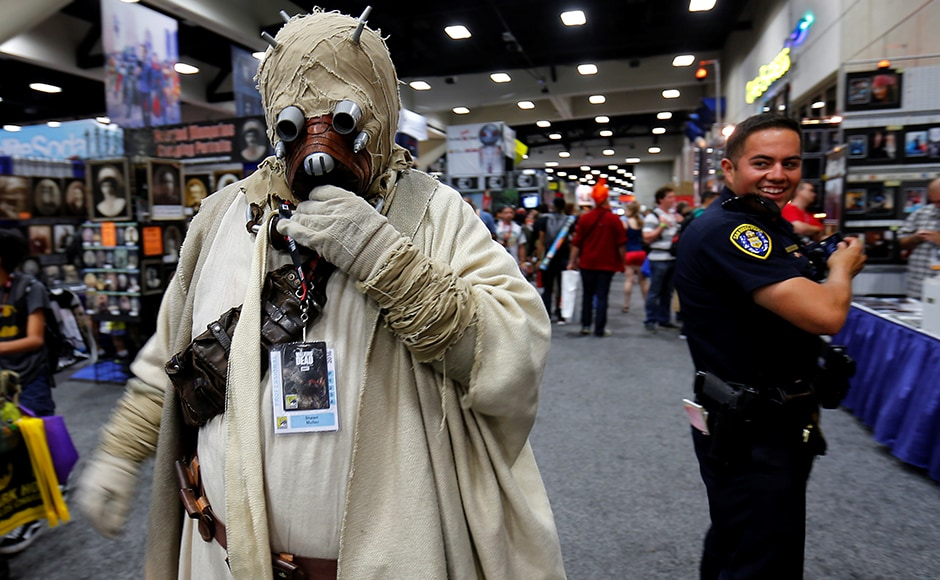 "Hundreds of fans were treated to a special outdoor screening of ""Star Trek Beyond"" with a live orchestra and fireworks. A police officer takes a second look at an attendee's Star Wars Tusken Raider costume while patrolling the convention floor on Thursday. Reuters"