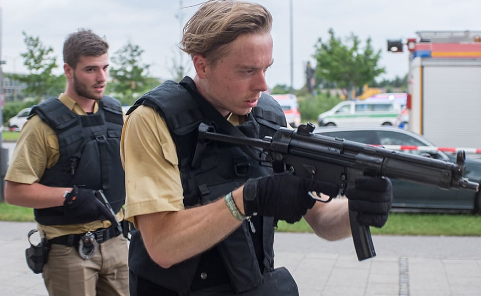 The German rail company Deutsche Bahn has stopped train traffic to Munich's main station and Munich public transit operator MVG has shut down all subway, bus and trolley cars because of the police operation to find the shooters. DPA via AP