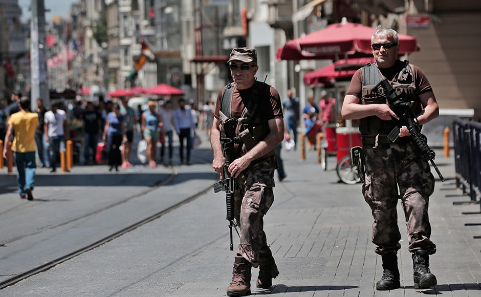Turkish police special forces officers patrol outside the French consulate in central Istanbul's Istiklal Avenue, the main shopping road of Istanbul, Friday, July 15, 2016. Security forces continue to patrol the area around the French consulate in Istanbul on Friday, a day after an attack in the French resort town of Nice. AP