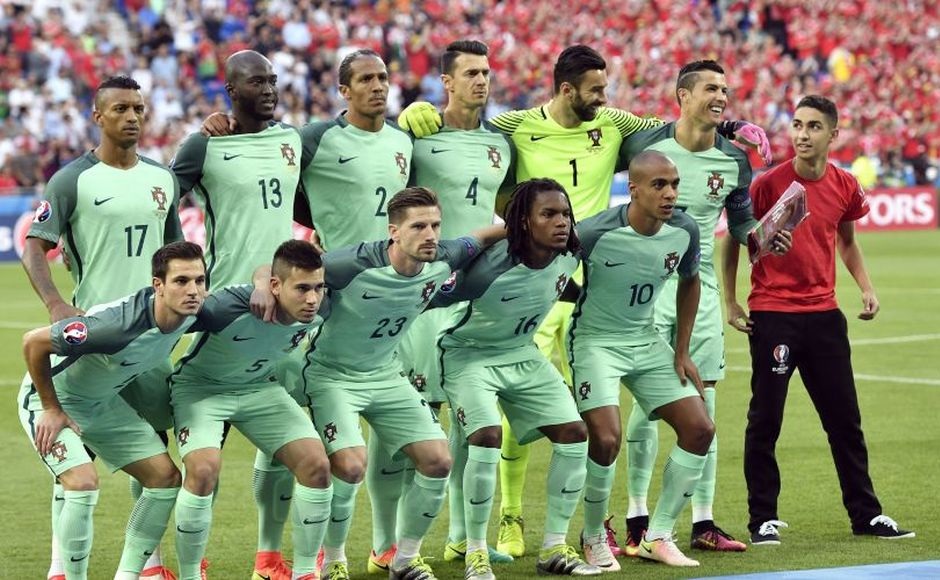 A surprise guest joins the Portugal national team for the group photo before the game as Cristiano Ronaldo offers a smile. AP