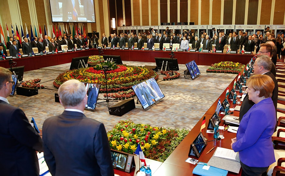 Leaders stand for a minute of silence for the victims of a deadly attack in the French city of Nice, before the opening session of the Asia-Europe Meeting (ASEM) summit in Ulaanbaatar, Mongolia, Friday, on 15 July, 2016. AP