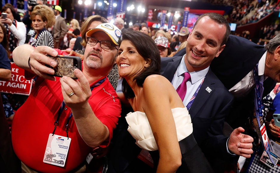 Delegates pose for pictures with South Carolina Governor Nikki Haley on the floor during the third session. Haley too has not fully endorsed Trump, stating only in an interview with MSNBC that Hillary Clinton needs to be defeated. Reuters