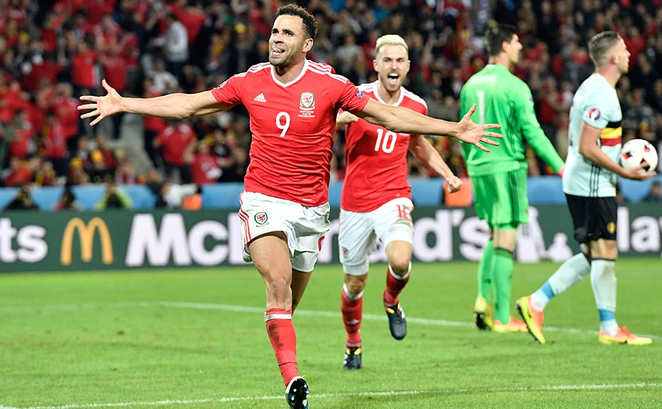 The man of the moment Hal Robson-kanu peals away in celebration after putting Wales on course for their first quarter-final appearance at Euro 2016. AP