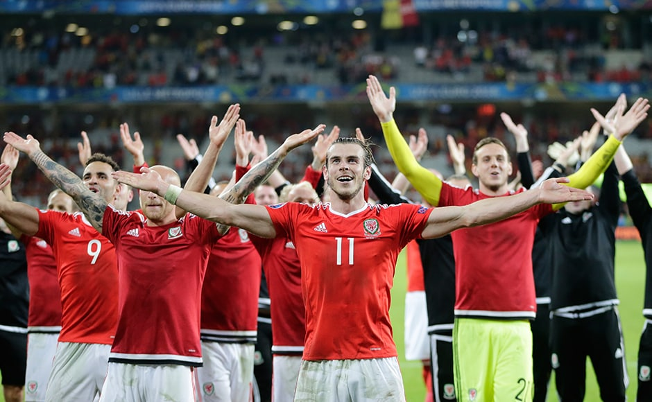 Wales savour the historic moment of reaching their first ever semi-final at a European Championship with their fans after a 3-1 win over Belgium. AP