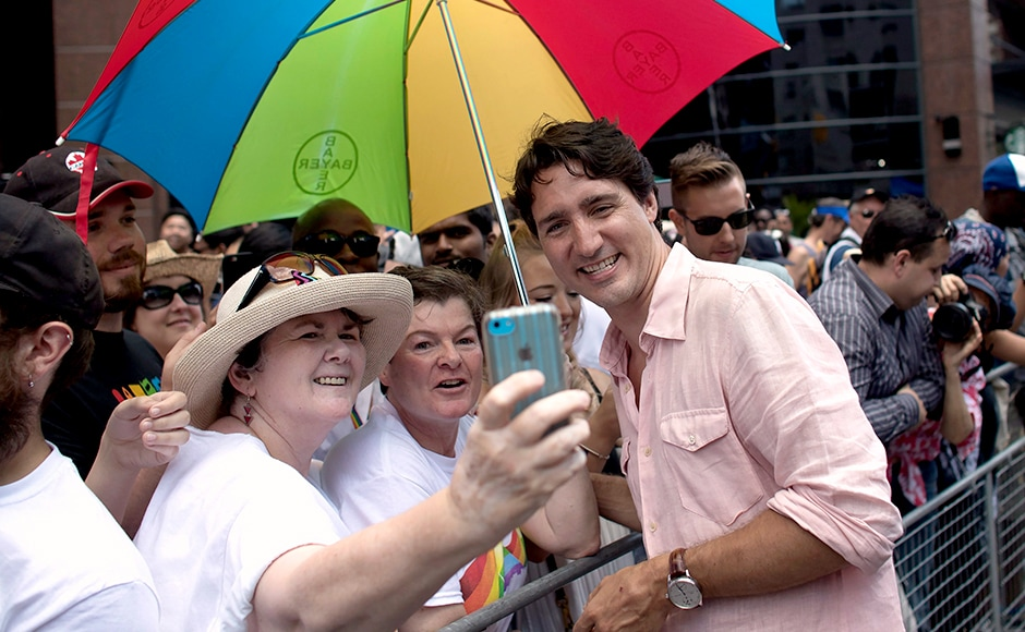 Members of the crowd posed for selfies with Trudeau, even as others chanted his name as he passed by. Photo Courtesy: AP