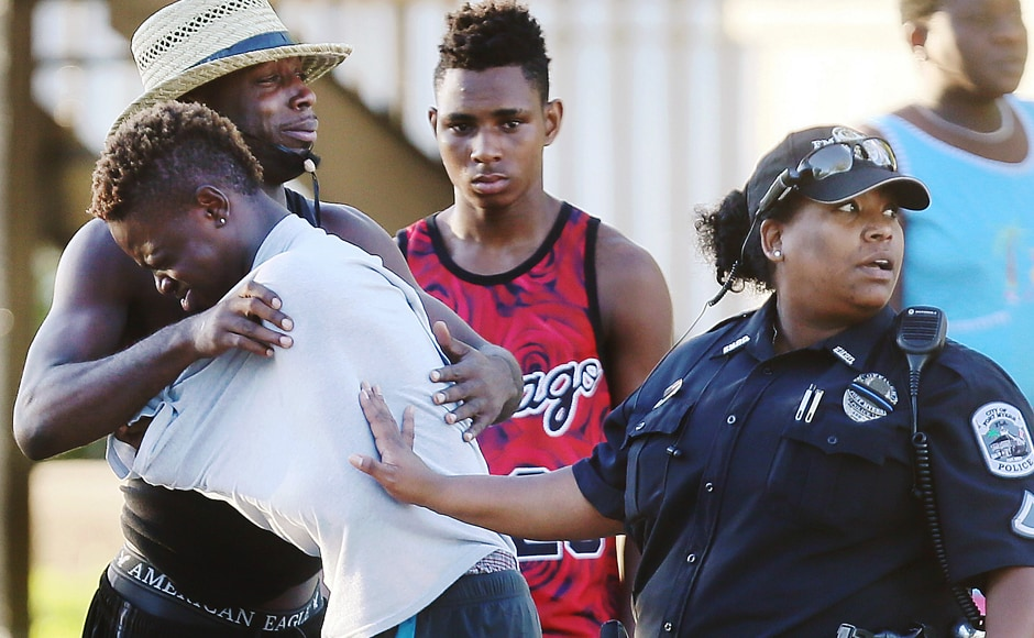People embrace after a fatal shooting at Club Blu in Fort Myers, Florida.  AP