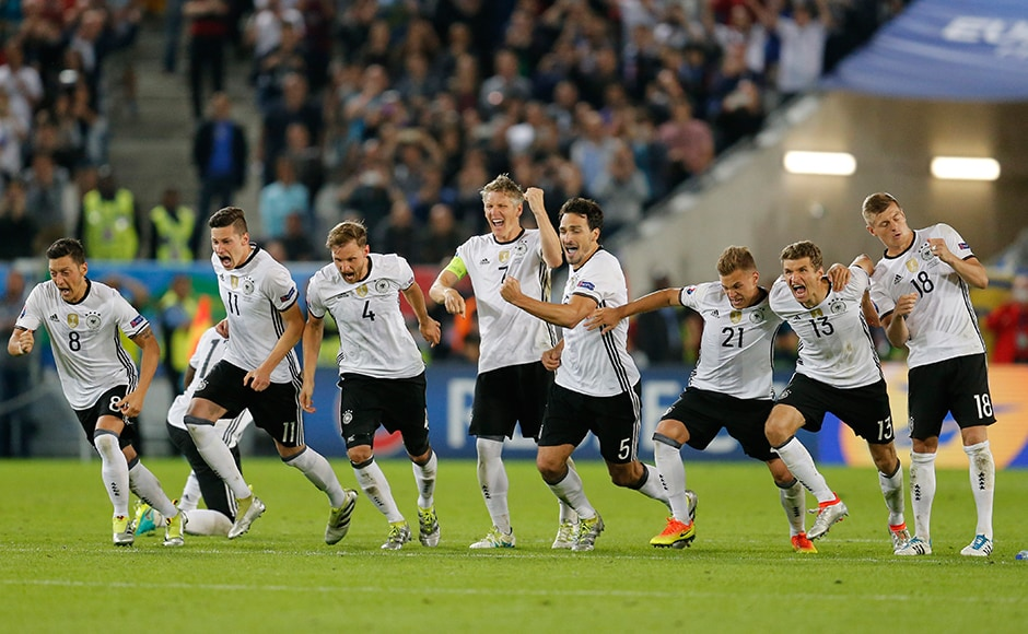 Winning moment: Germany players break out in celebration after clinching a thrilling penalty shootout win over Italy and break the long hoodoo against the Azzurri. AP